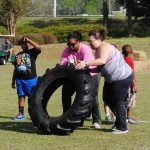 Angela and Lillie flip tires!